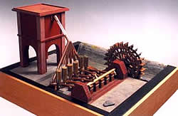 Von Wasserrad angetriebener früher 'Sechszylinder' als Modell